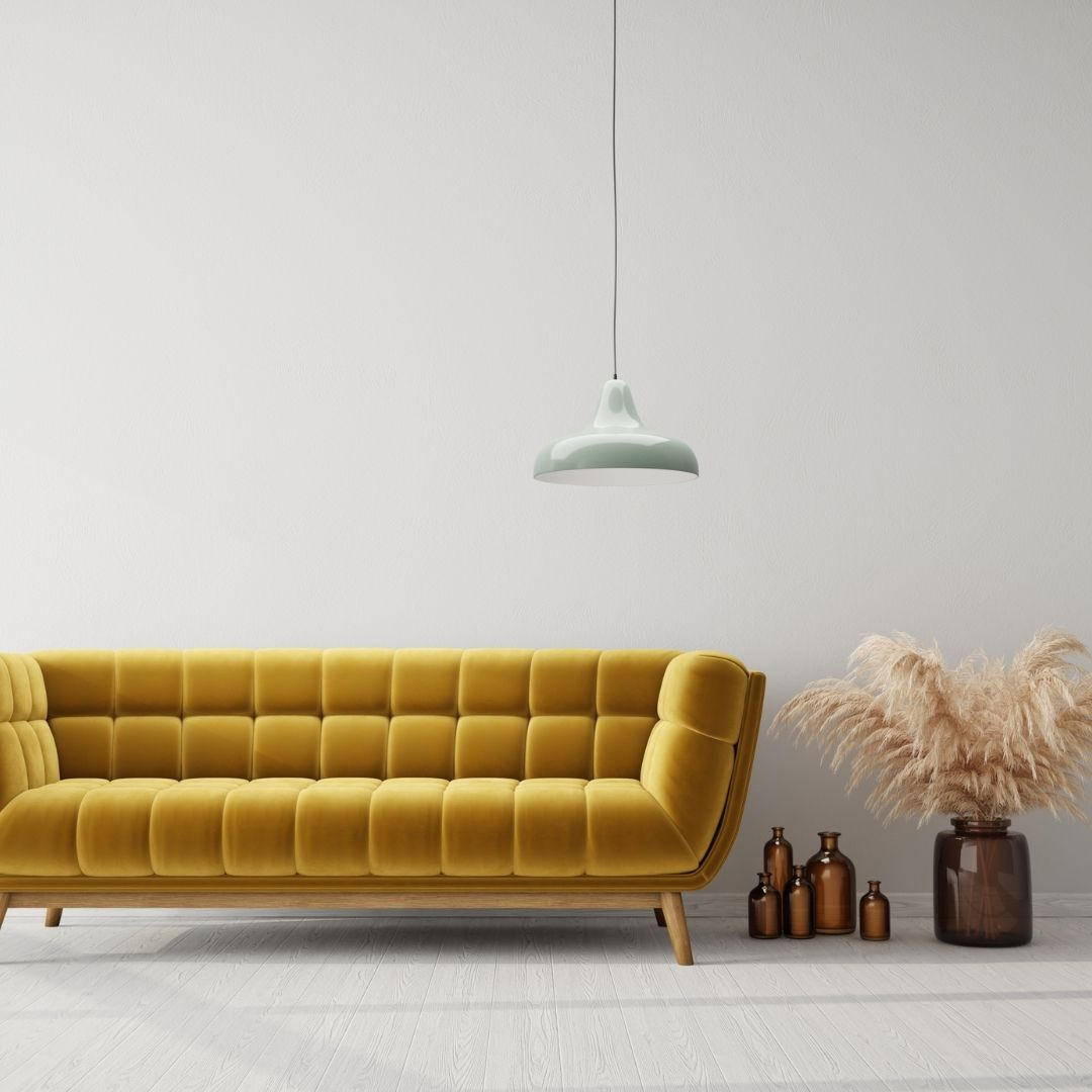 Living room featuring a yellow sofa and hanging pendent light