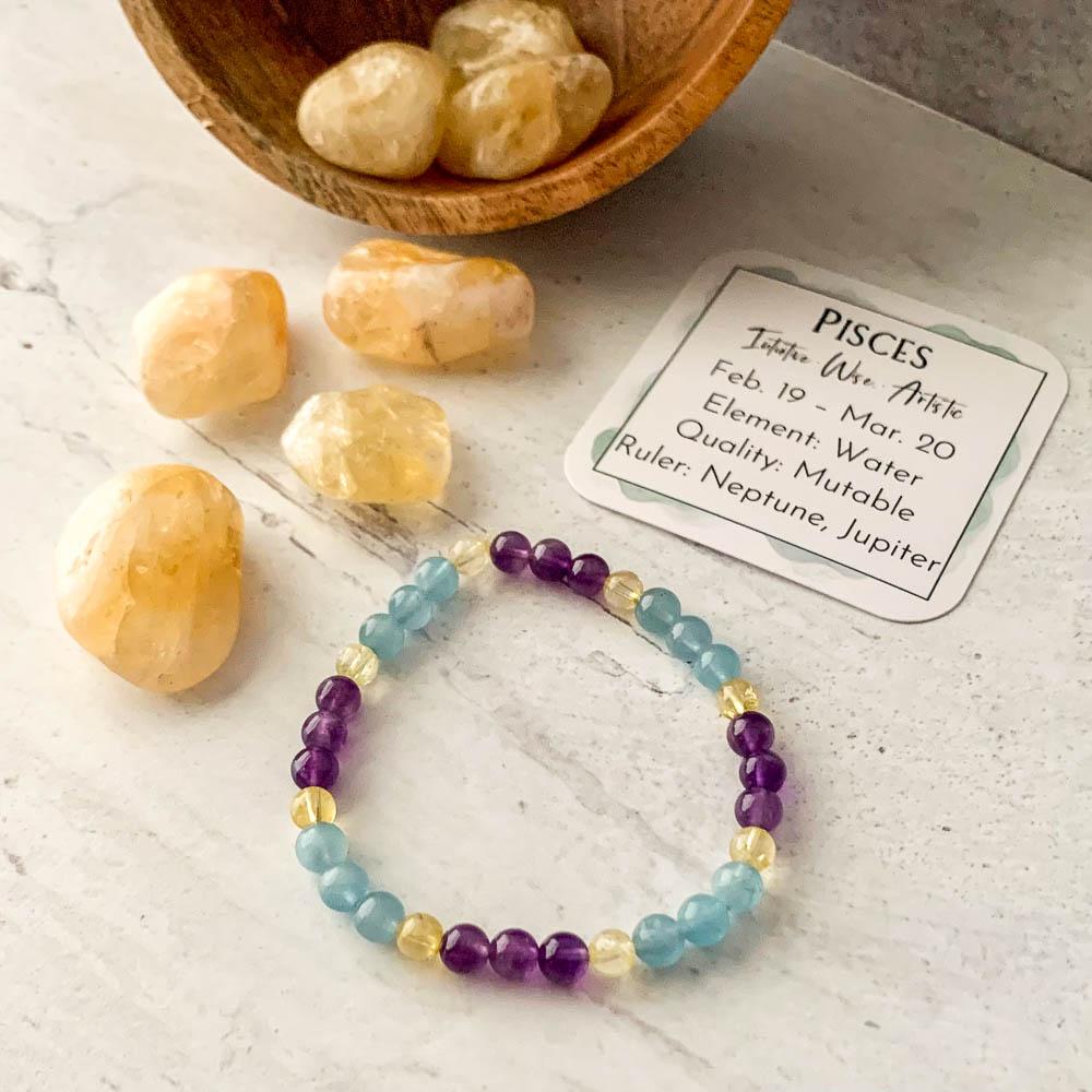 pisces zodiac crystal bracelet with aquamarine amethyst citrine