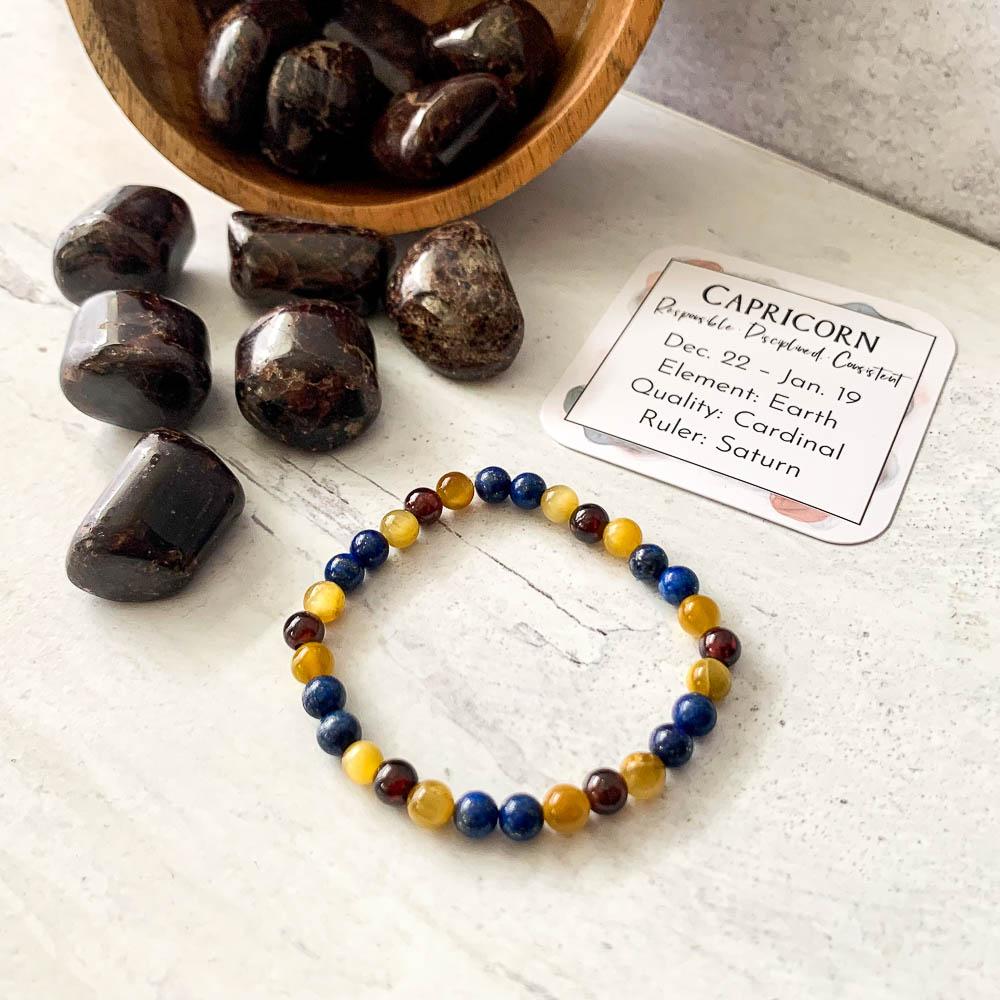 capricorn crystal zodiac bracelet with garnet tiger eye and lapis lazuli