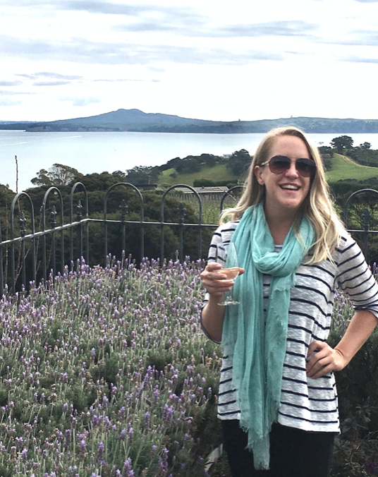 Anuket founder Ashlee Dozier in New Zealand holding a glass of wine