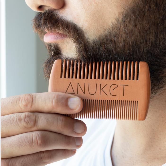 Man using Anuket sandalwood beard comb on facial hair