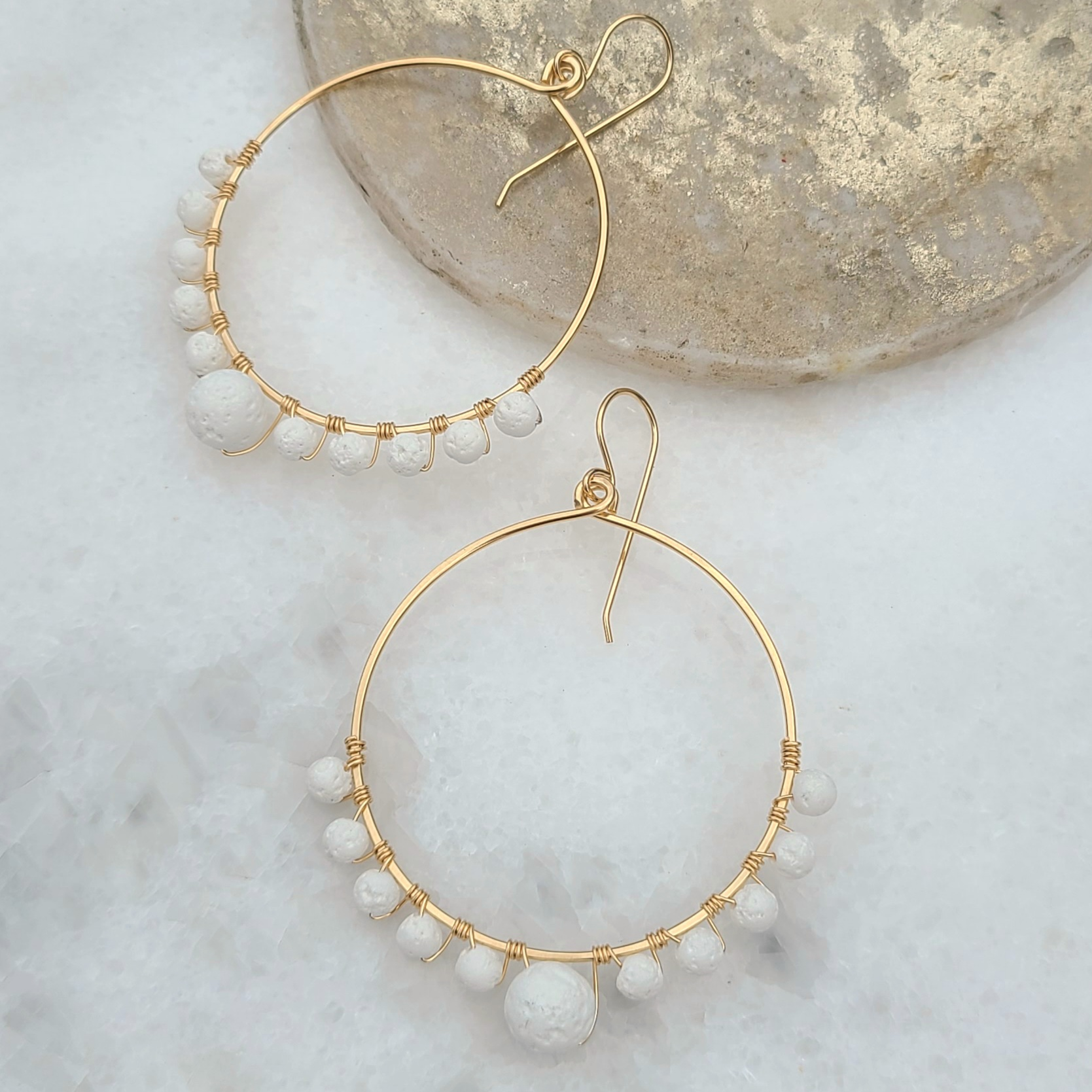 Anuket x James & Jezebelle Oasis Earrings demi-fine gold hoops with white lava rock stones for diffusing fragrance jewelry