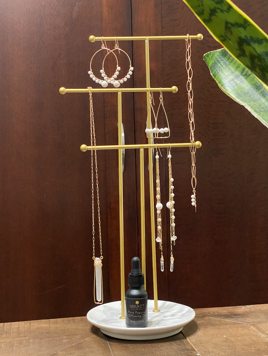 Anuket x James & Jezebelle demi-fine jewelry capsule collection and papyrus diffusing oil