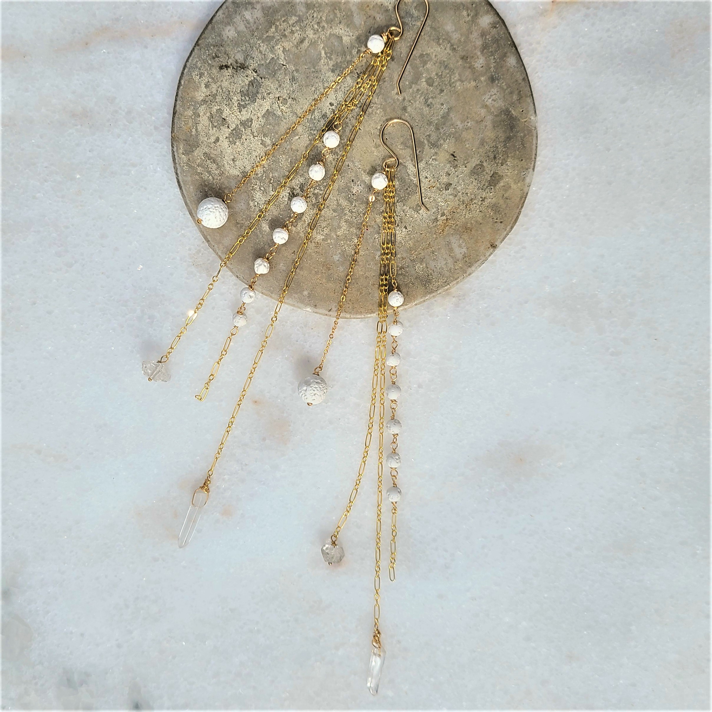 Anuket x James & Jezebelle Nile Earrings demi-fine gold drop earrings with white lava rock stones and herkimer diamonds  for diffusing fragrance jewelry