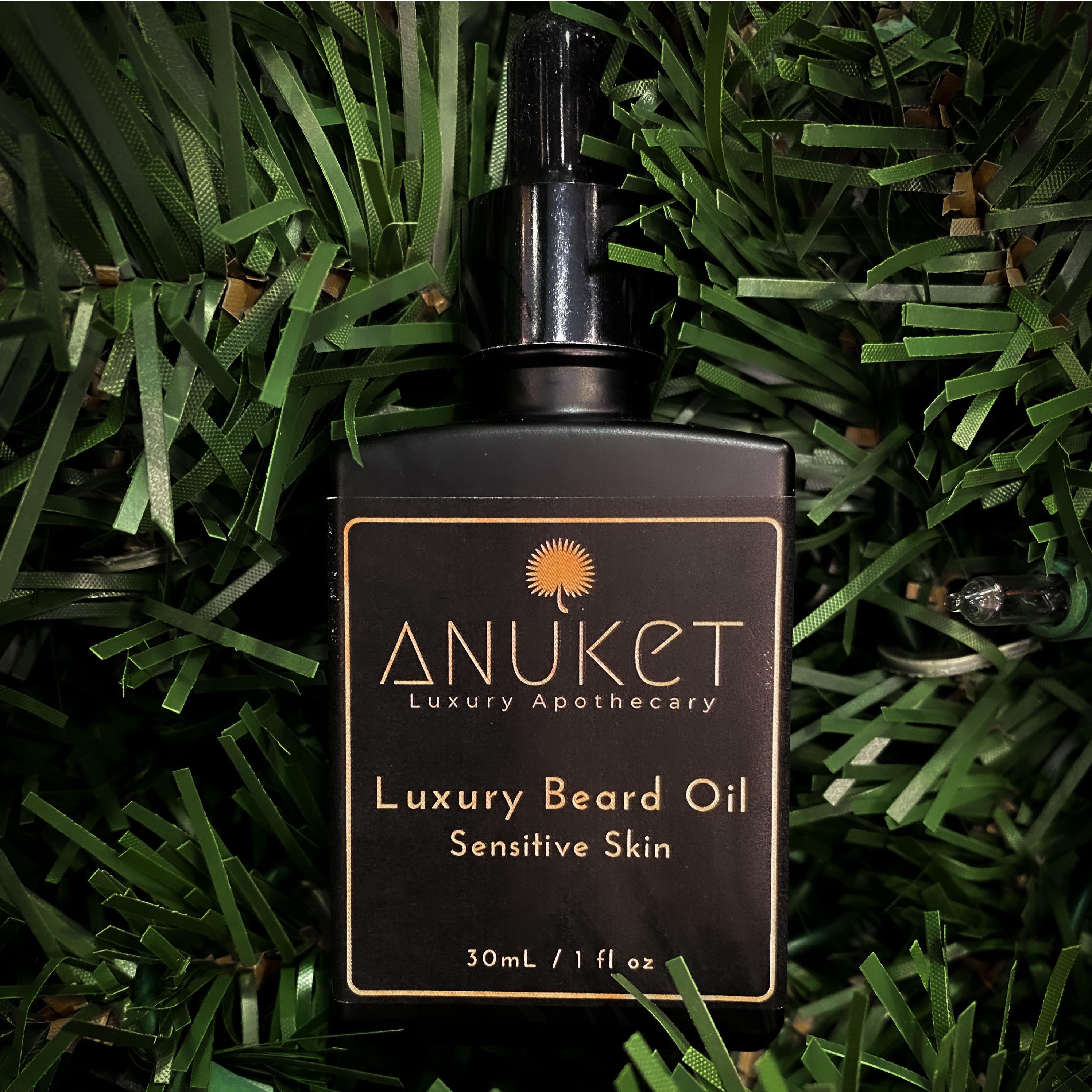 Image of Anuket Luxury Apothecary's Sensitive Formula Luxury Beard Oil laying on a background of greenery