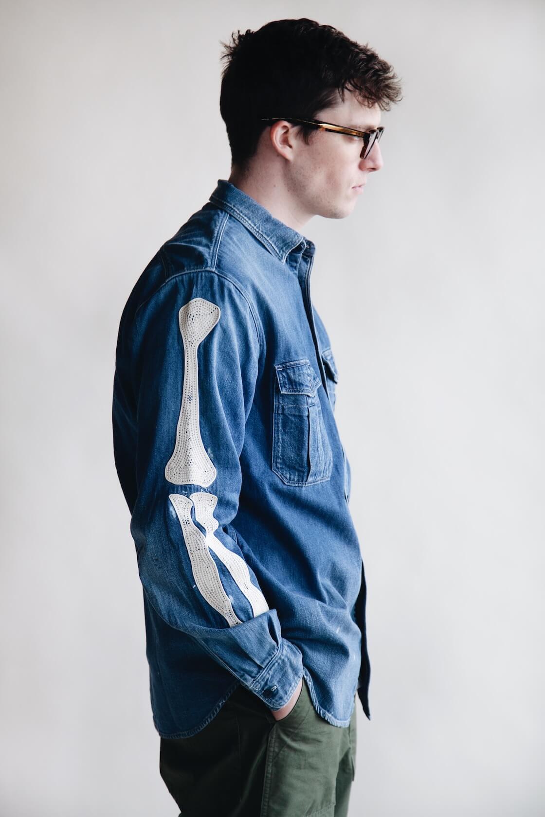 kapital work shirt with arm bones on body