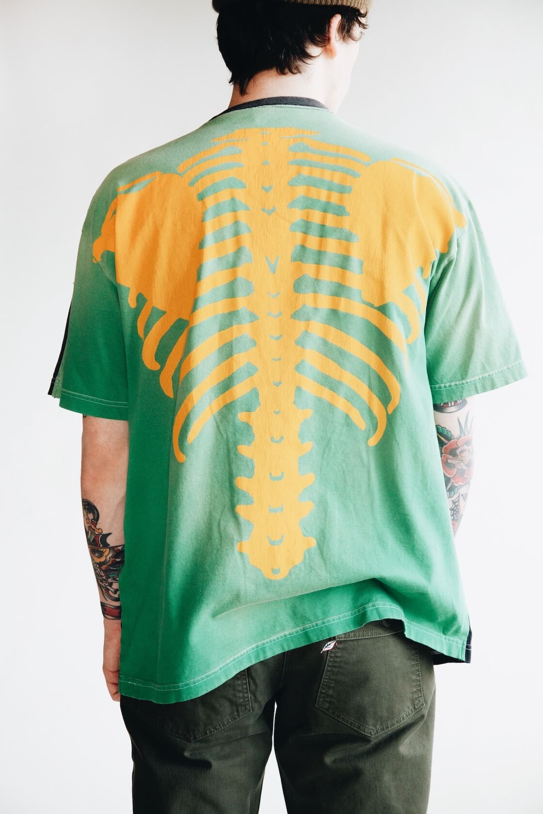 kapital kountry bones tee in green and orange on body