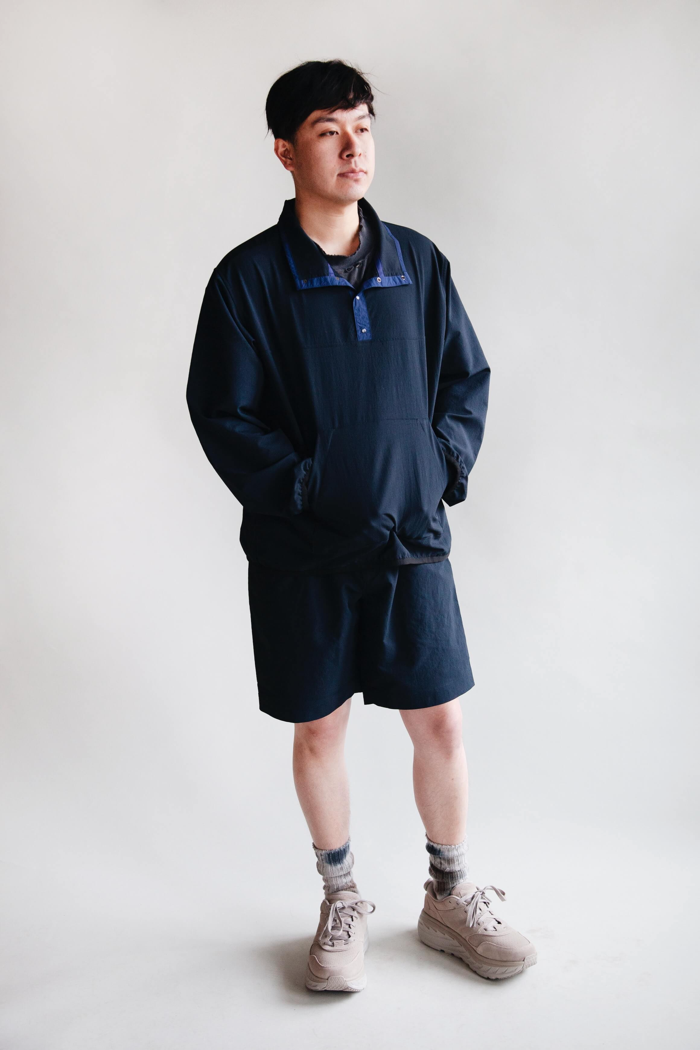 nanamica alphadry pullover jacket and easy shorts, anonymous ism uneven dye socks and hoka one one bondi L suede shoes on body
