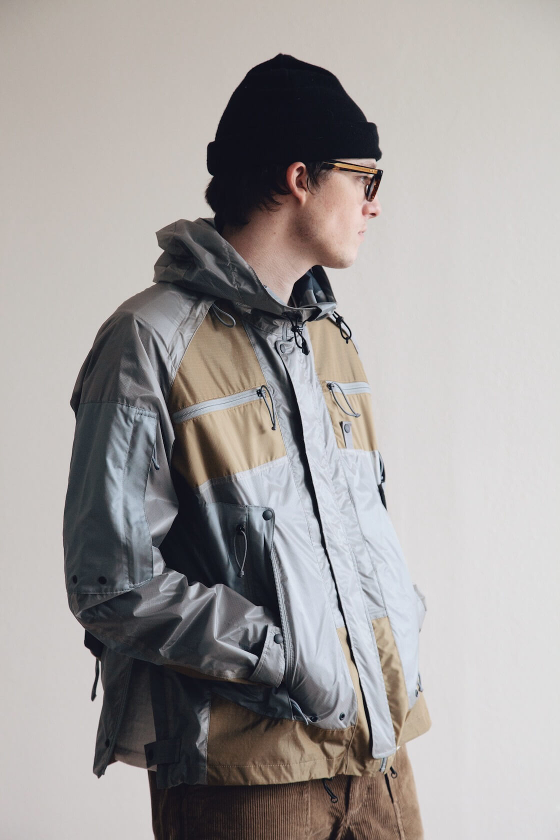 junya watanabe x mystery ranch backpack jacket, lady white co. t-shirt, engineered garments fatigue shorts and engineered garments x sebago overlap shoes on body