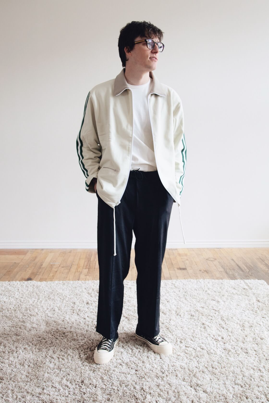 lady white co webbing track jacket, nylon band pants and tee as well as some visvim skagway lo g patten shoes on body