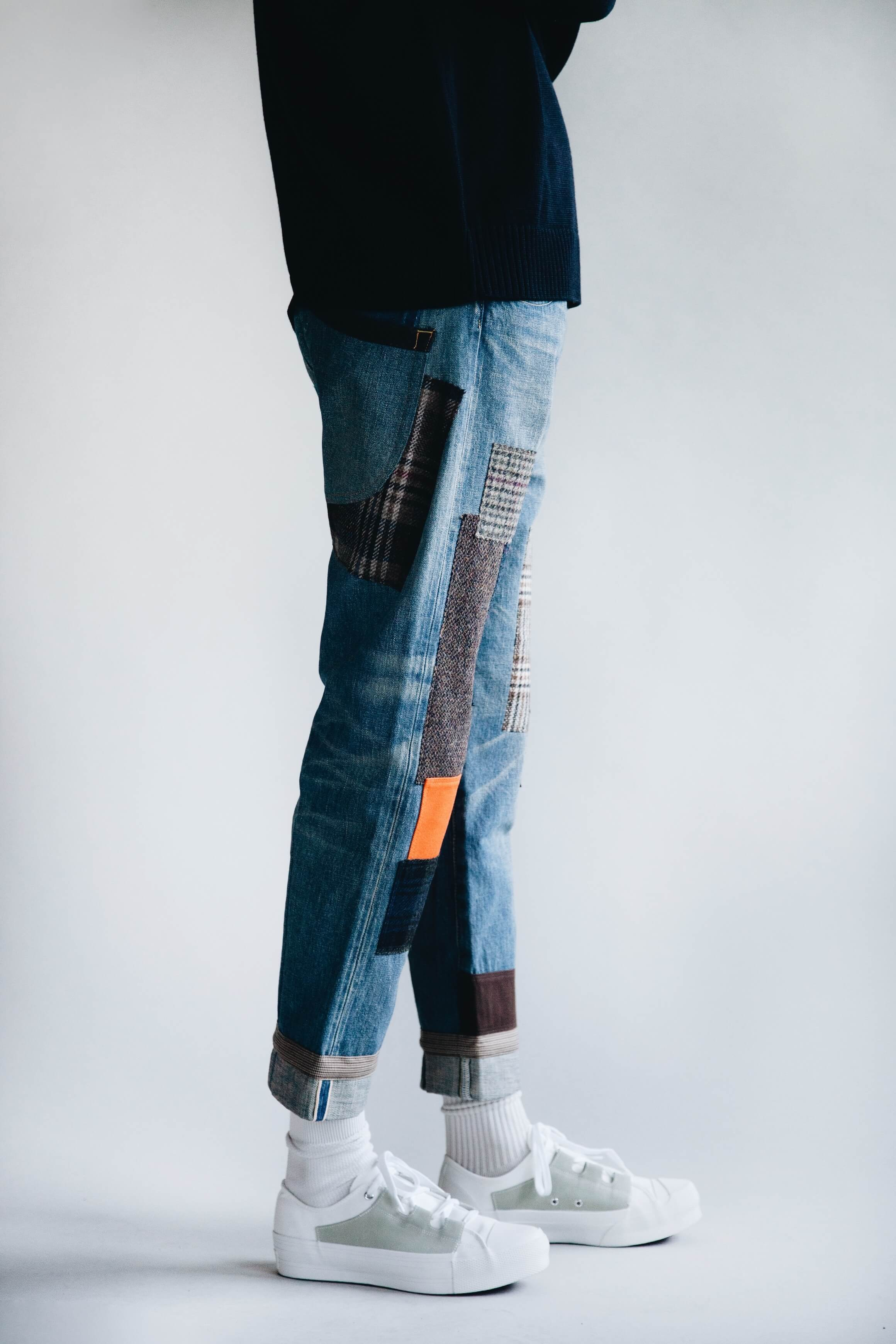 arpenteur dock sweater, junya watanabe garment treated denim and needles asymmetric ghillie sneakers on body