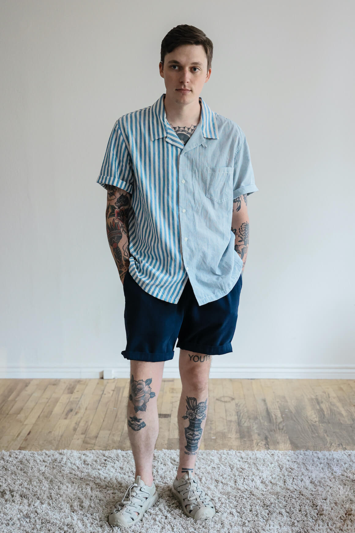 universal works beach shorts, howlin synth pop shirt, and hoka one one hopara shoes on body