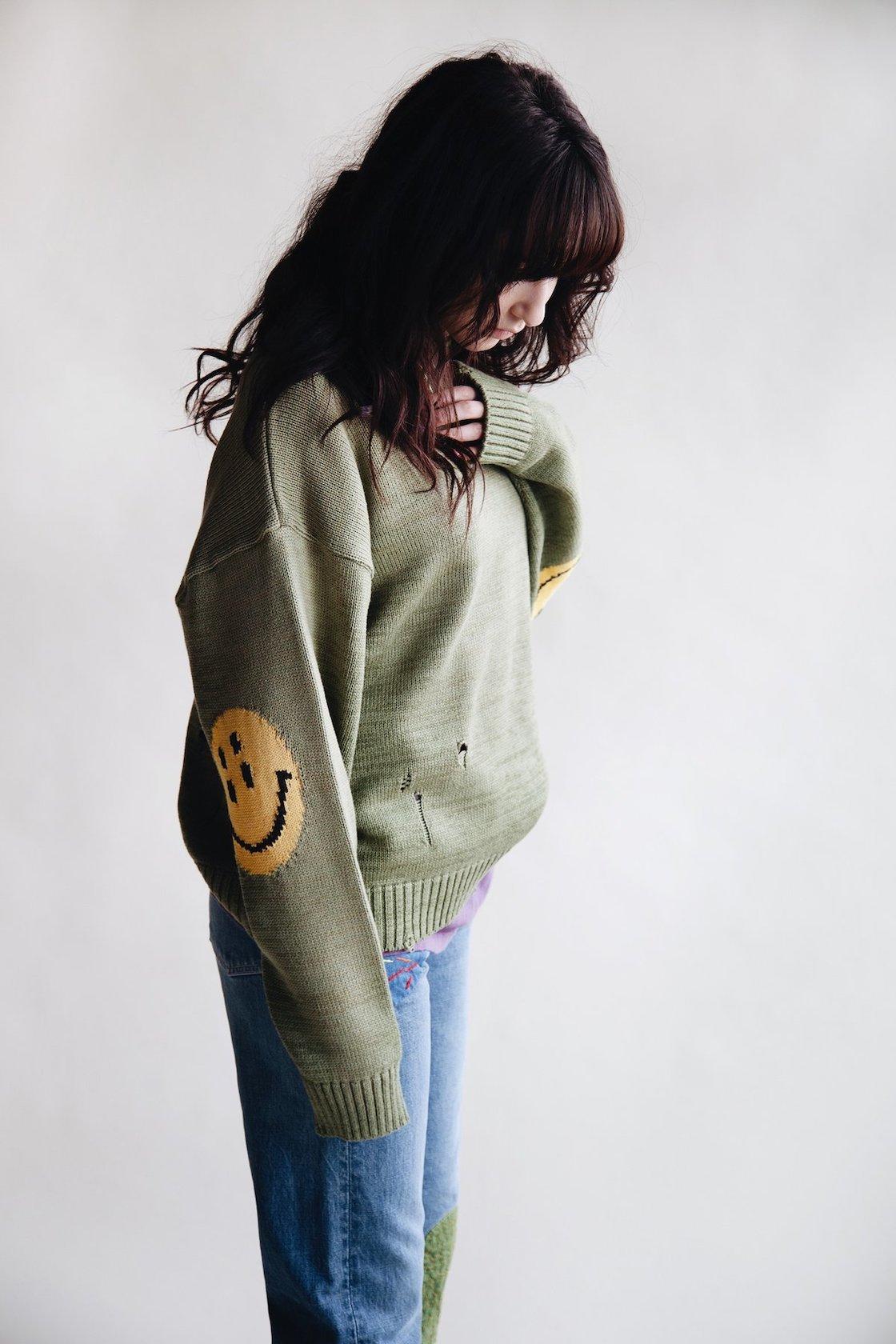 kapital rain smiles on elbows of sweaters on body