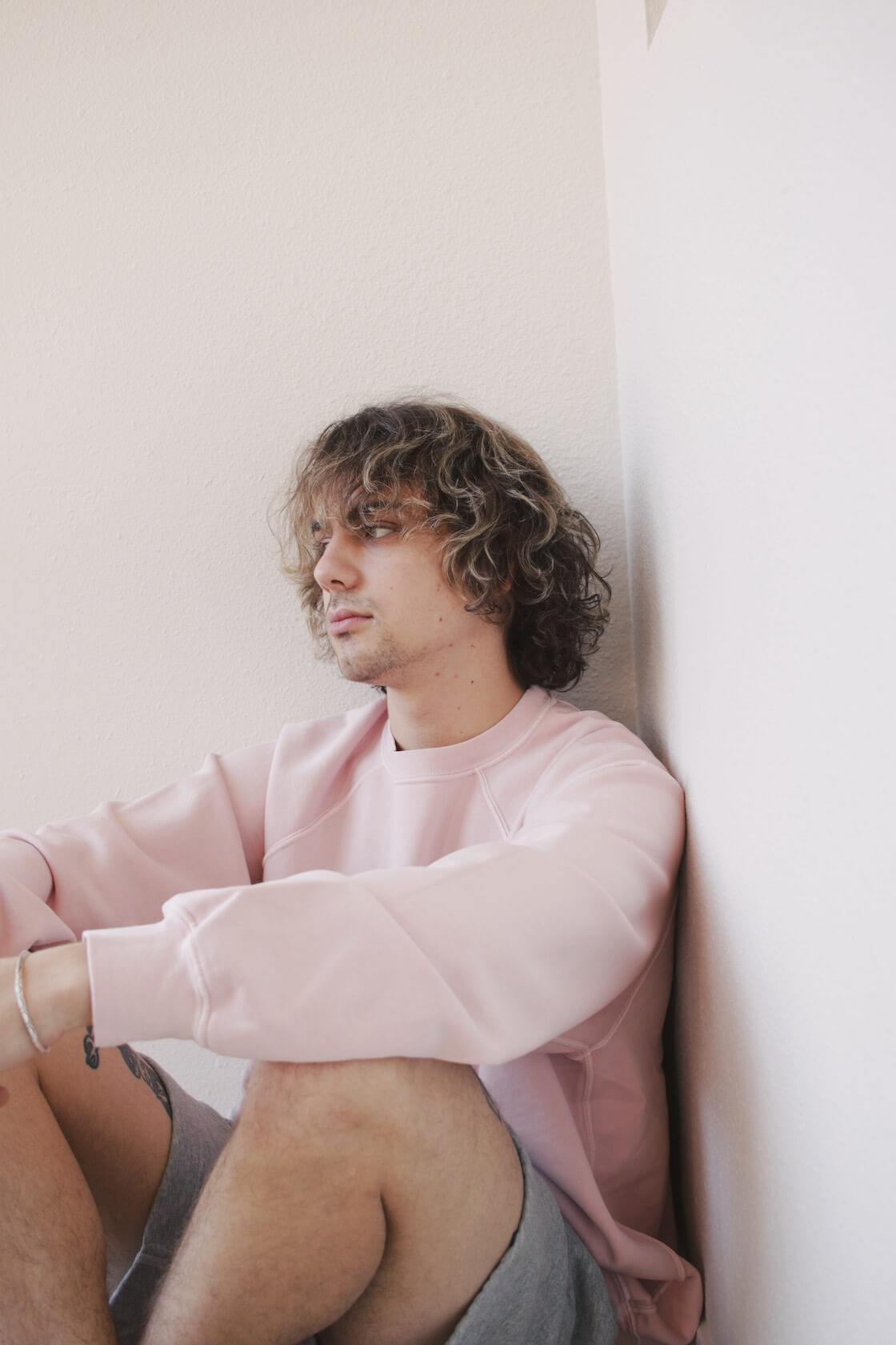 canoe club x lady white co. collaboration eraser pink jacob sweatshirt on body