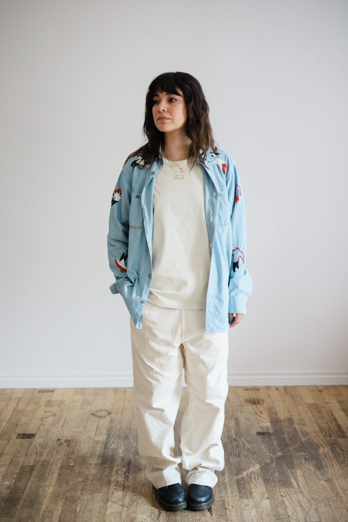 kapital light canvas welder overalls and embroidered chambray shirt on body