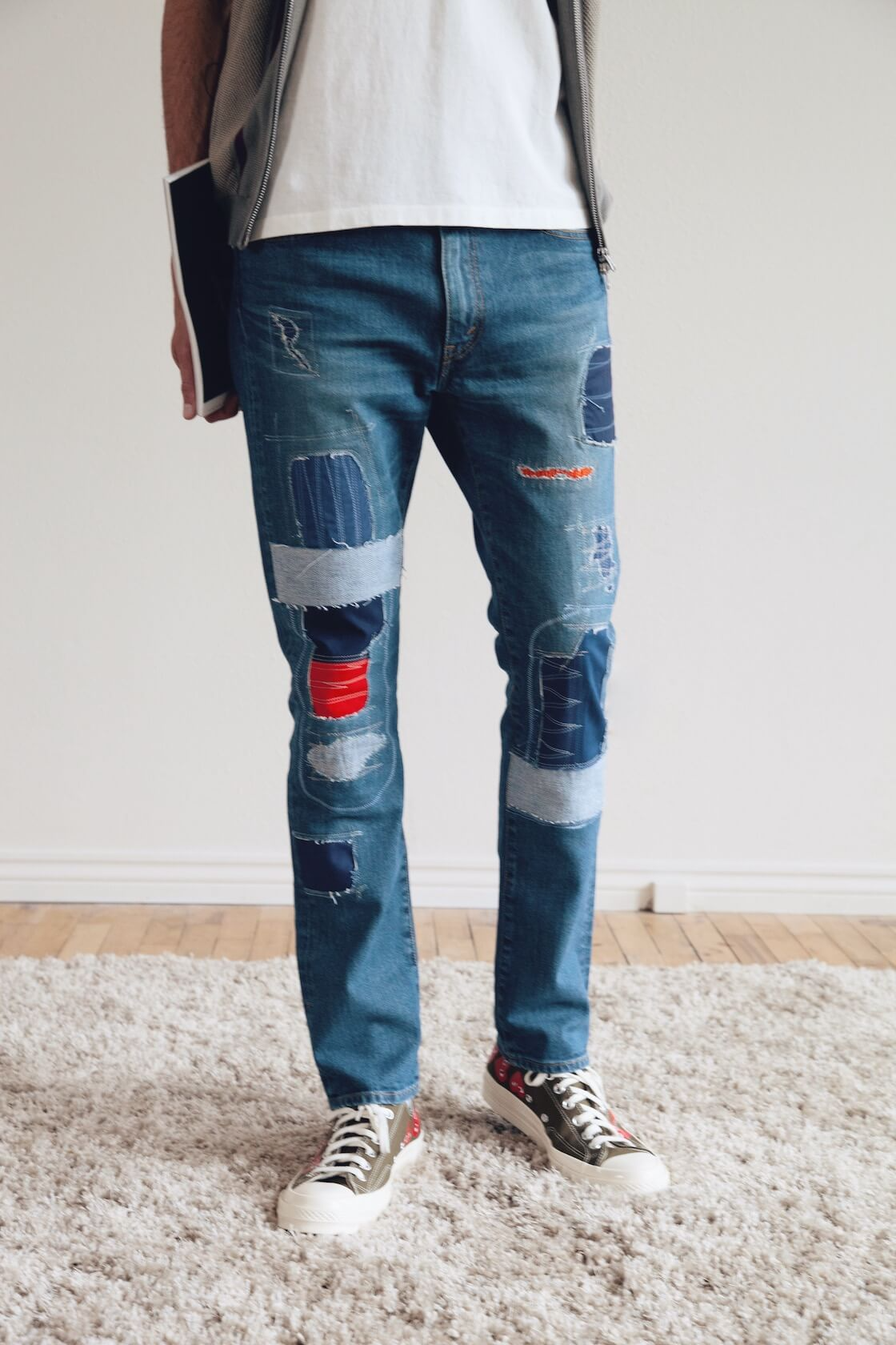 beams plus zip knit polo stripe, junya watanabe EYE x levi's patchwork 501 jeans, comme des garcons play x converse chuck taylors and fudge magazine on body