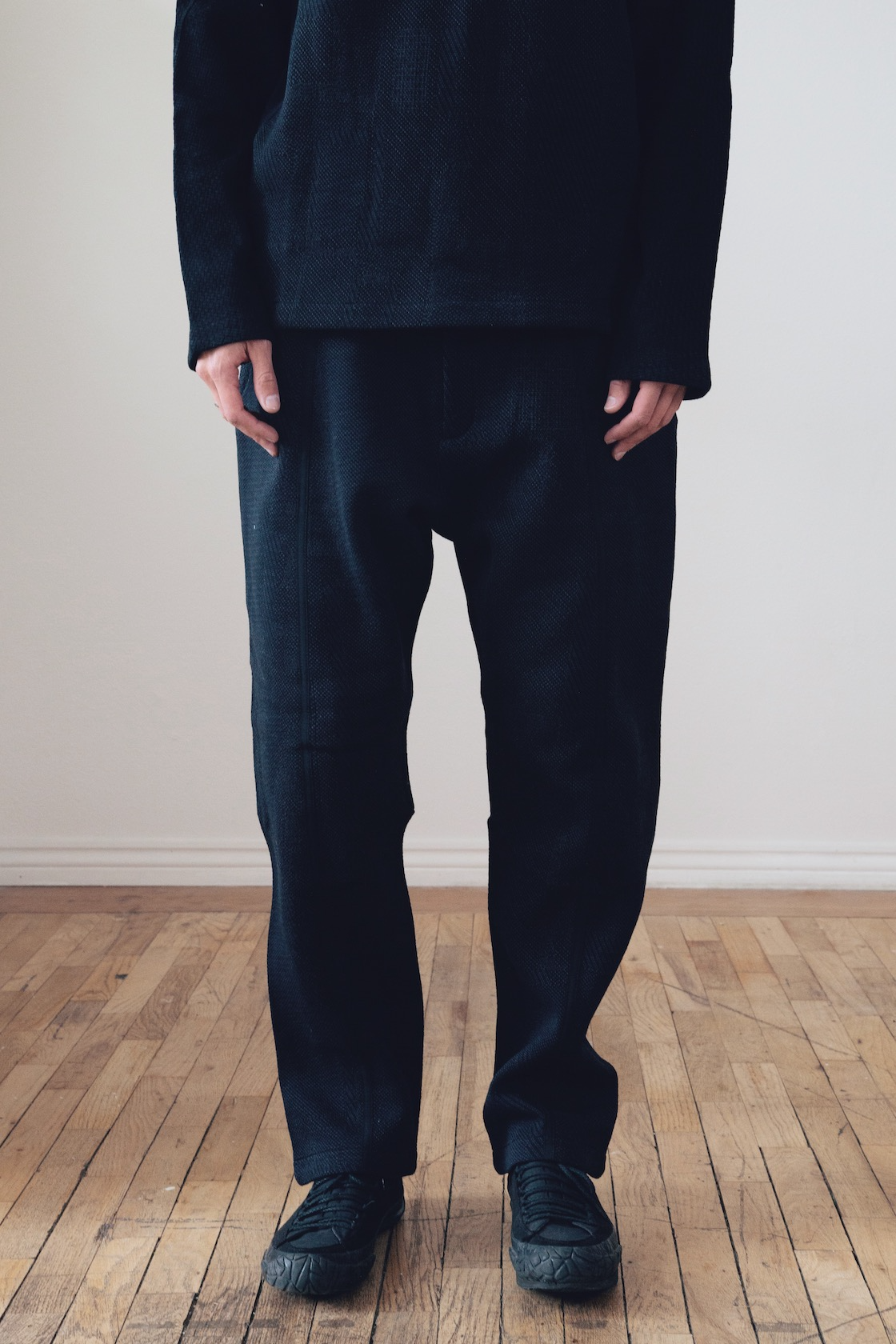 byborre suit jacket, lightweight map sweater and suit pants on body