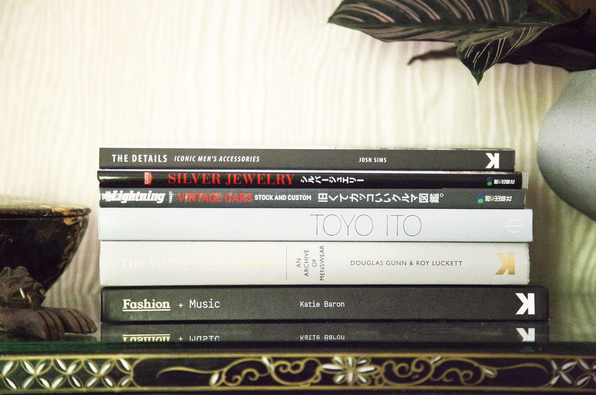 stack of books featuring the details by josh sims, lightning clutch silver jewelry and vintage cars, toyo ito, an archive of menswear by douglas gunn and roy luckett, and fashion plus music by katie baron