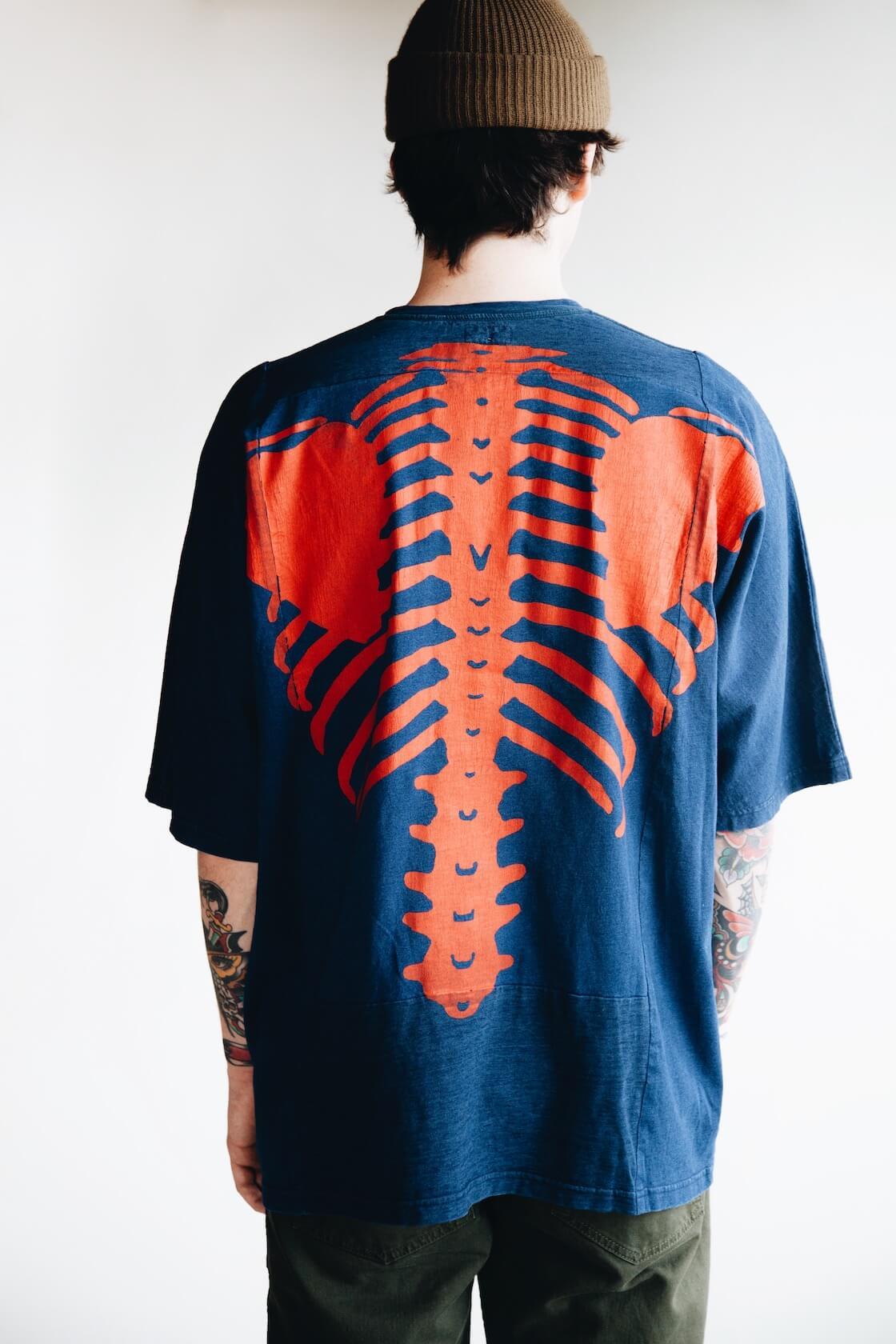 kapital kountry bones tee in navy and orange on body