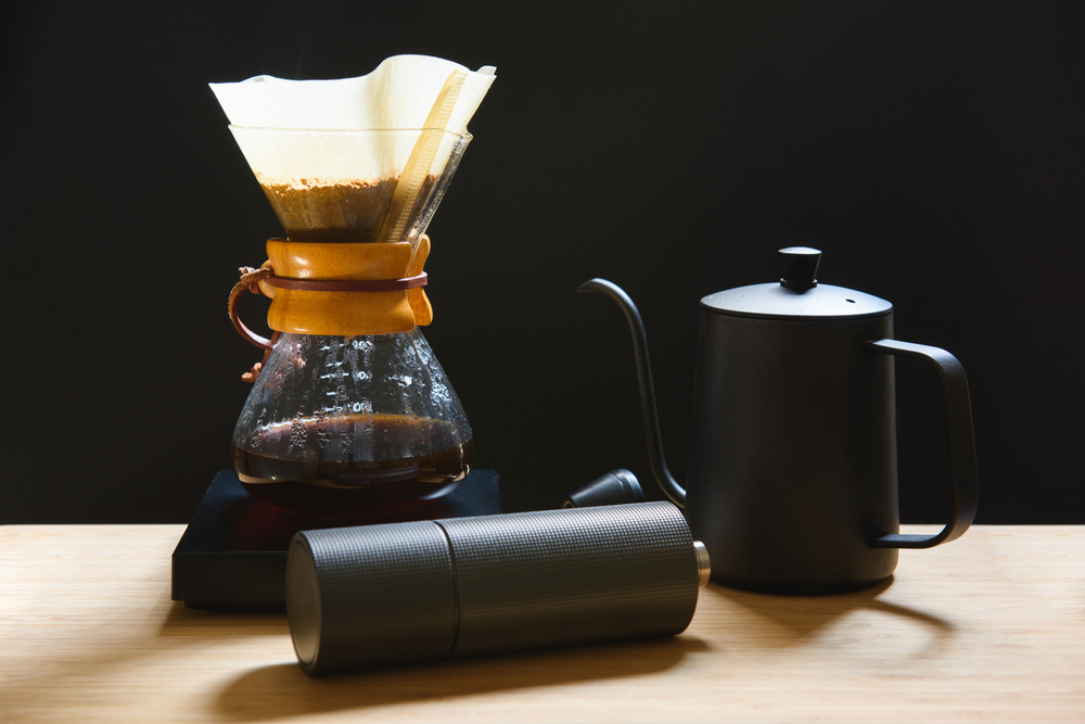 Coffee concentrate on a table with a black kettle