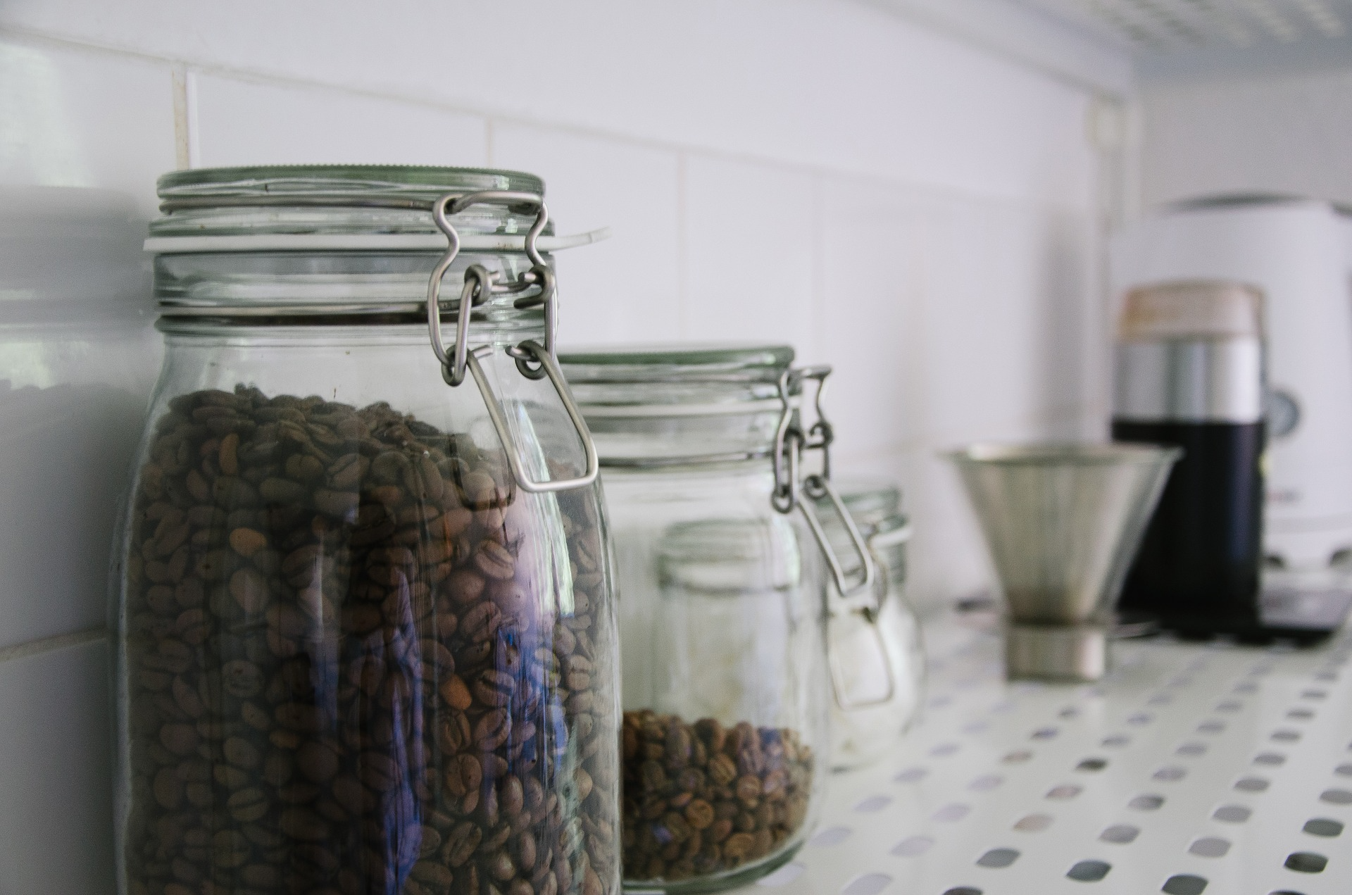Coffee beans stored in a canister