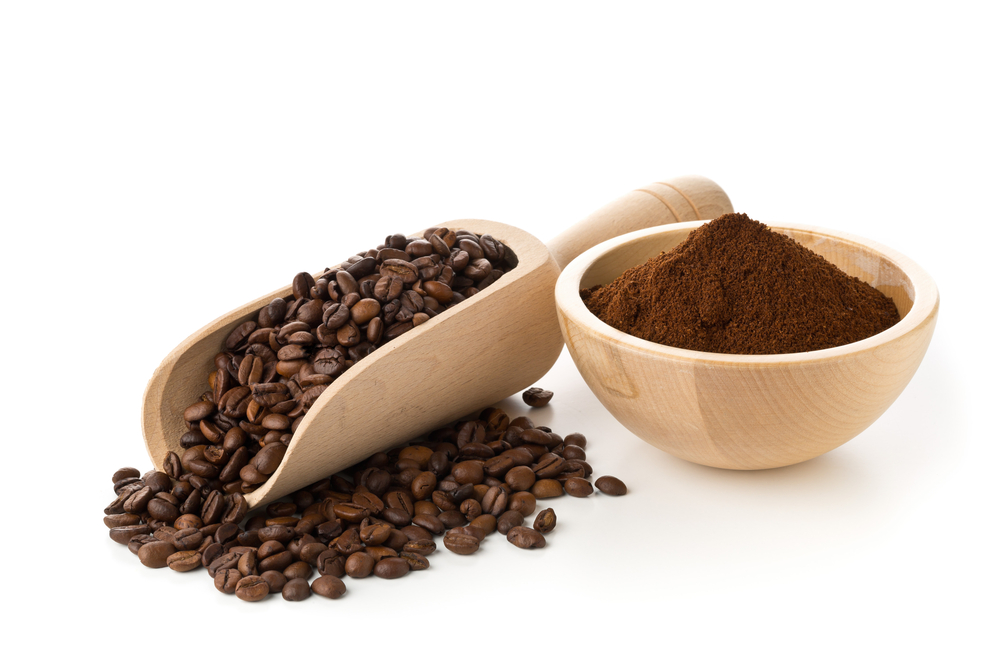 Coffee beans and grounds in a wooden bowl
