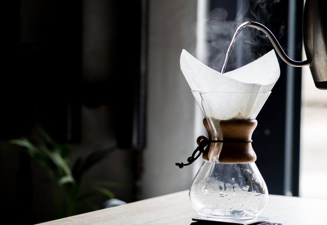Filtered hot water for coffee brewing