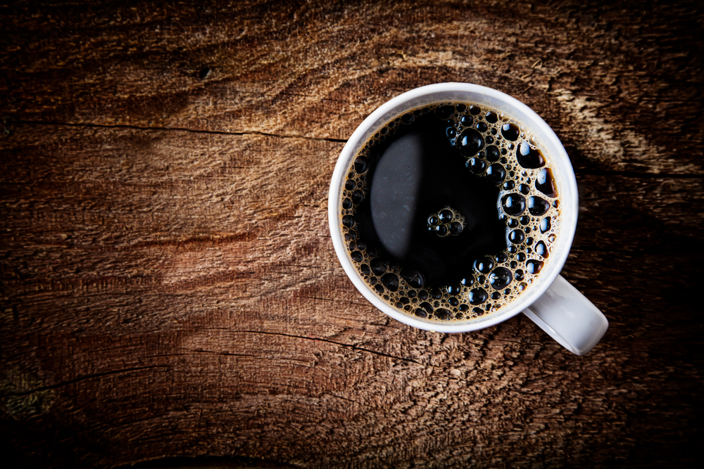 Cup of coffee on a wooden surface