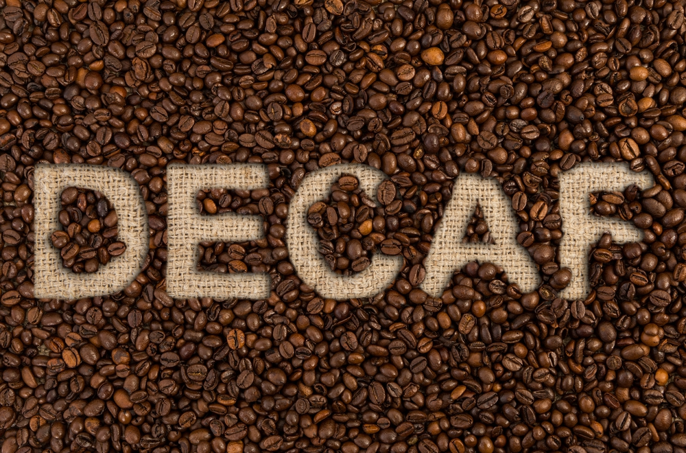 Coffee beans used to design the word ''decaf''