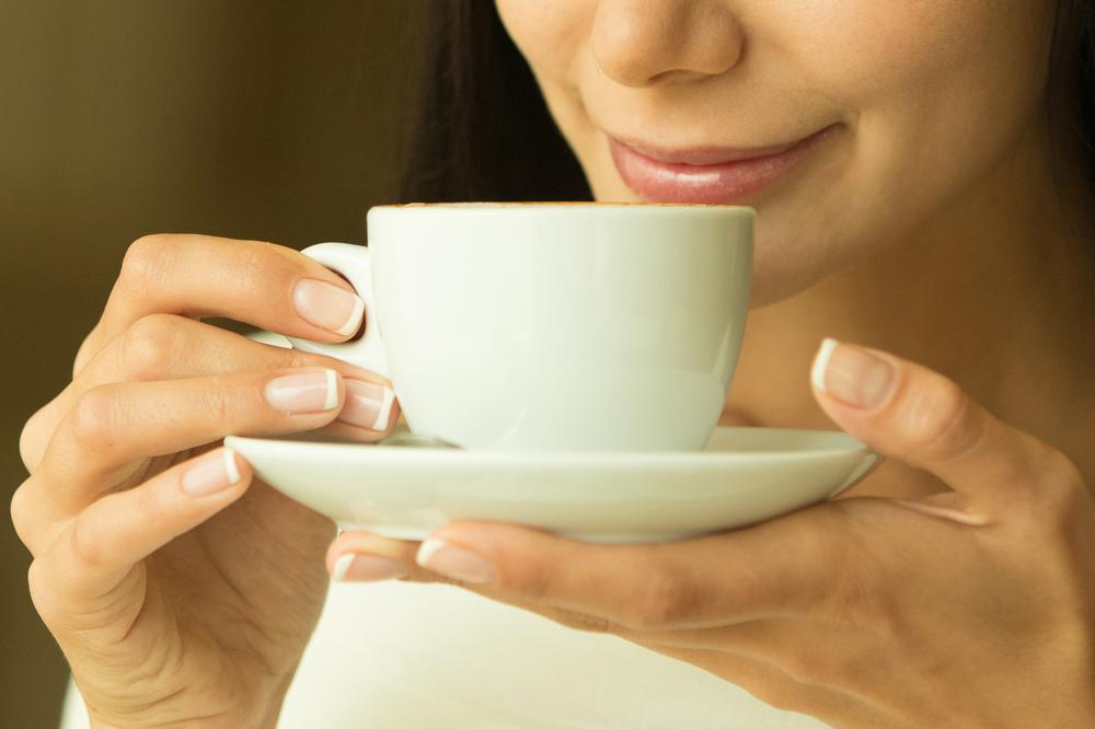 A Woman tasting coffee