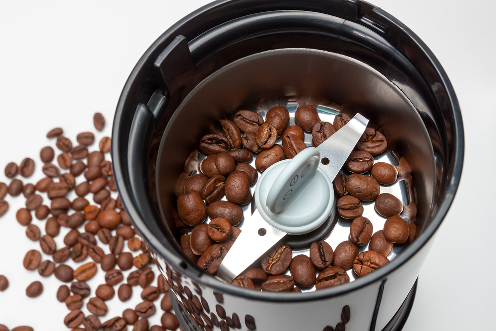 A blade grinder with coffee beans