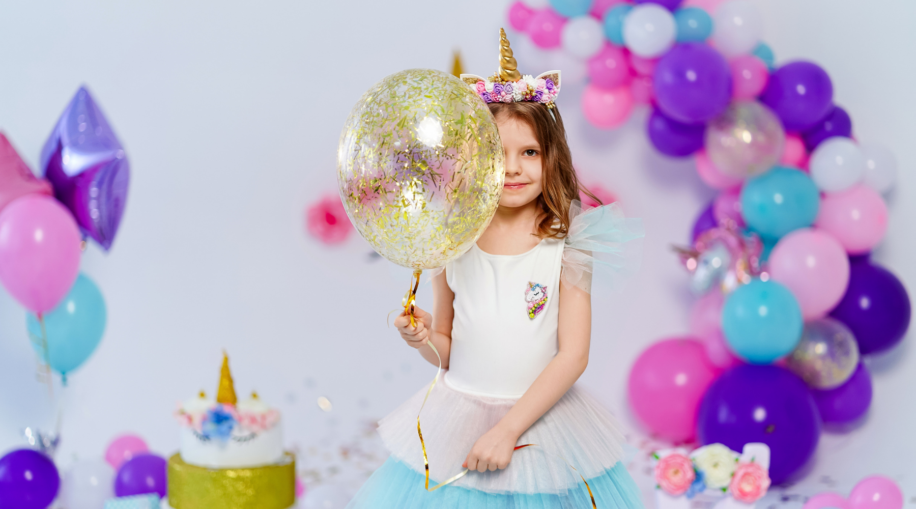 Unicorn birthday with pastel and gold balloons