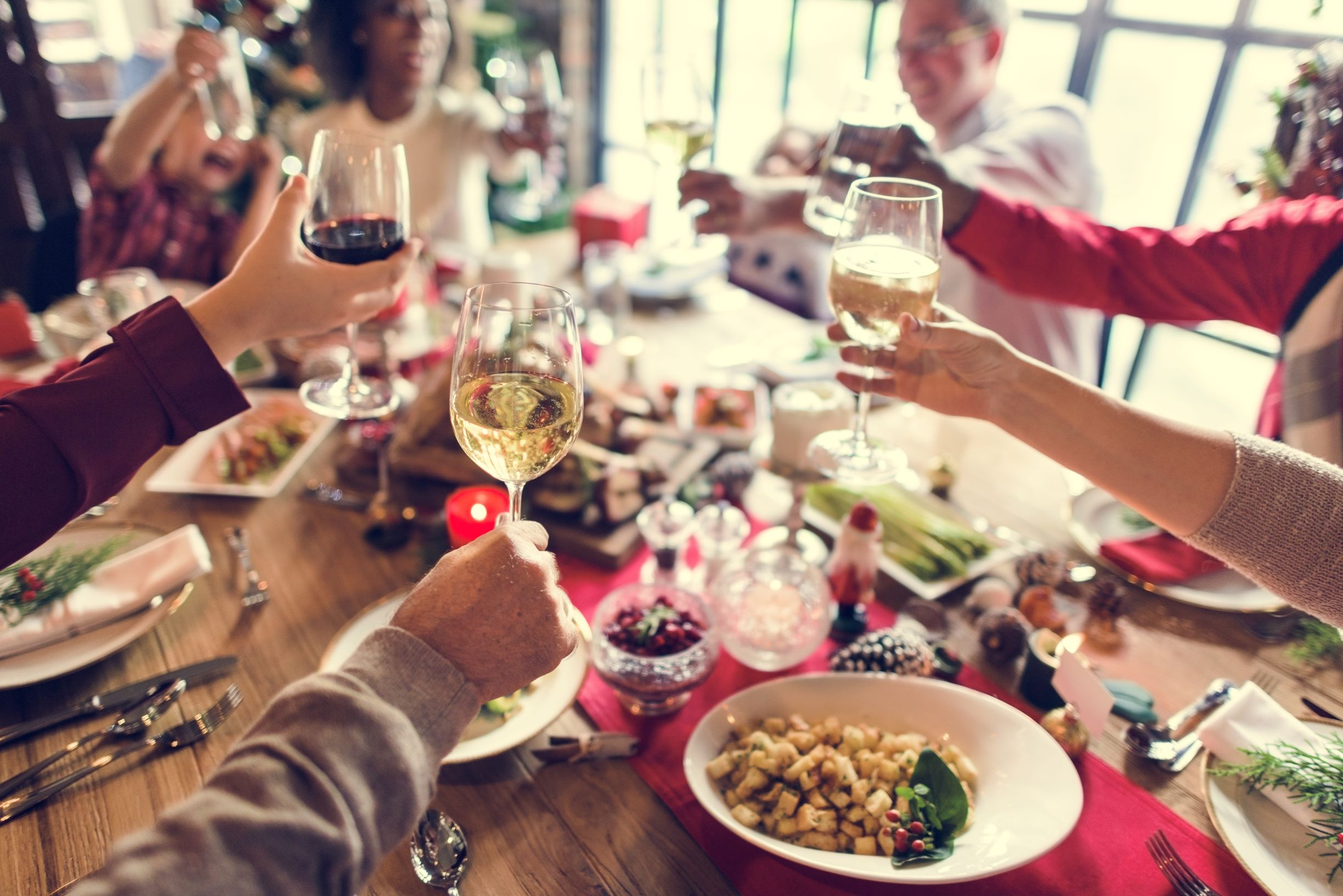 An intimate gathering over a beautifully setup Christmas table.