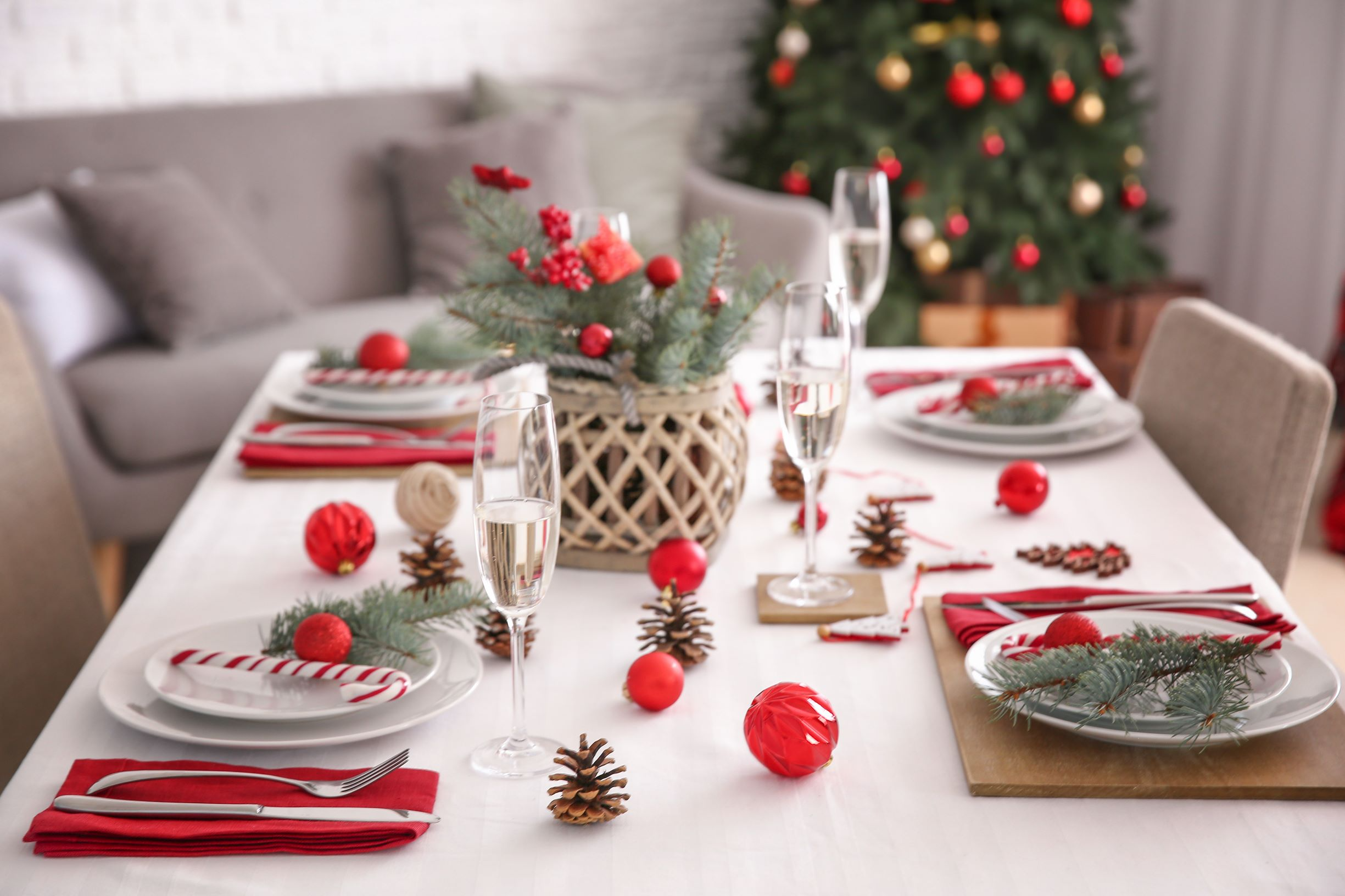 Classic Christmas table setup in red and green theme.