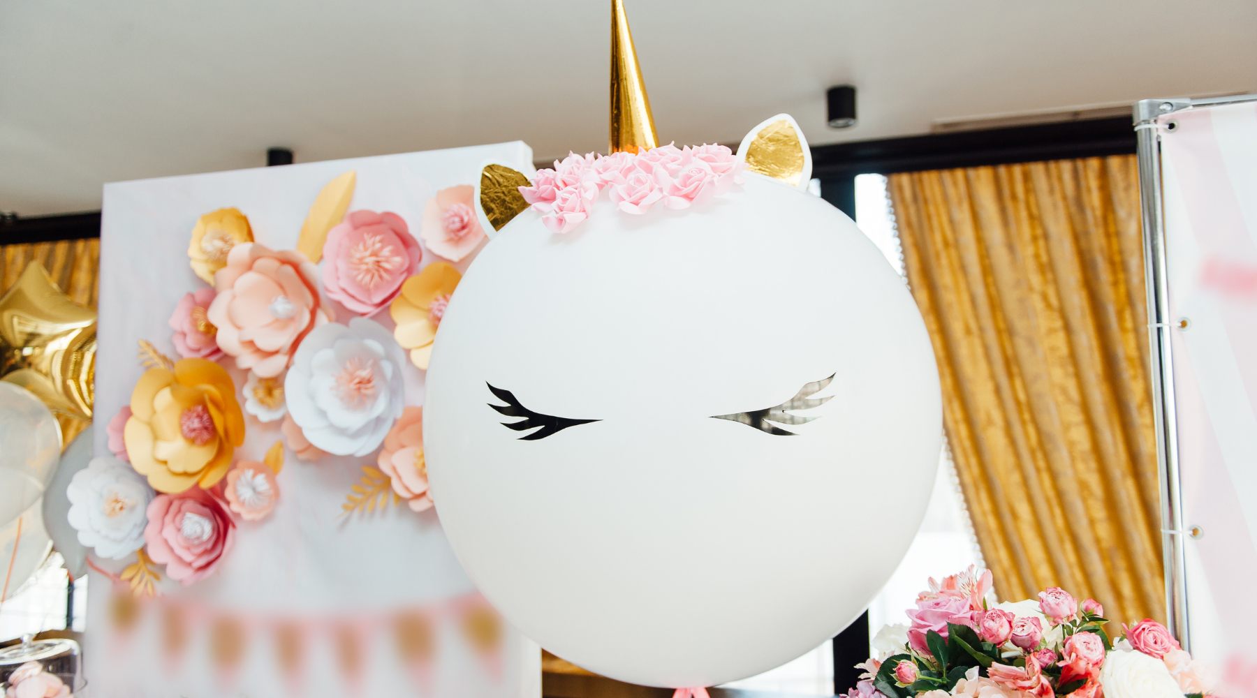 Unicorn birthday balloon and paper flowers
