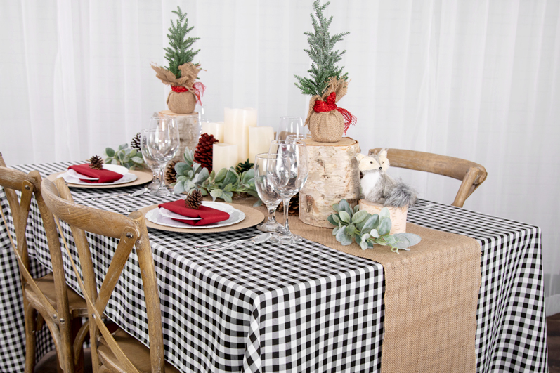 Gingham linen placemat for a rustic Christmas table setup.