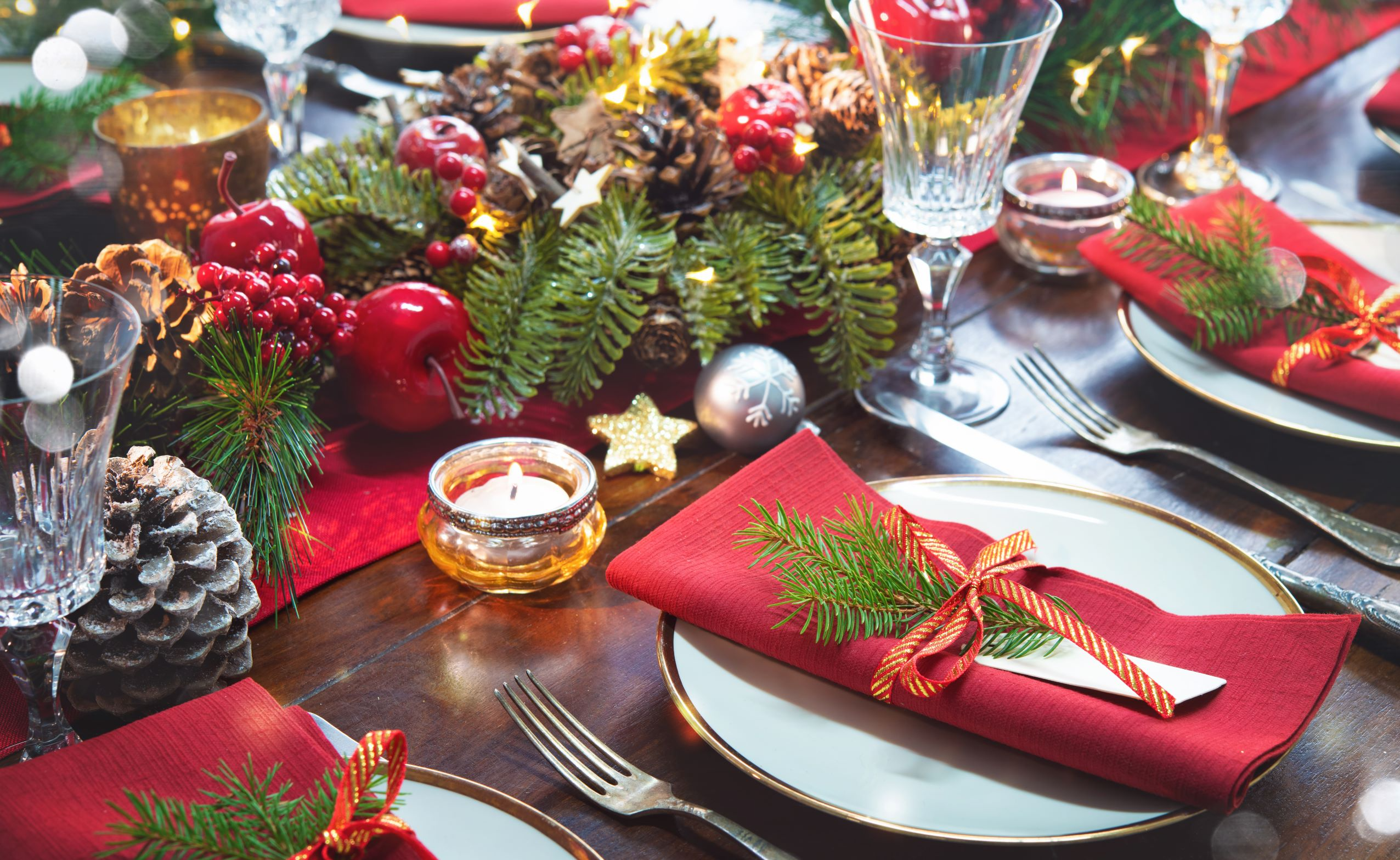 Personalized Christmas table setup with red and green theme.