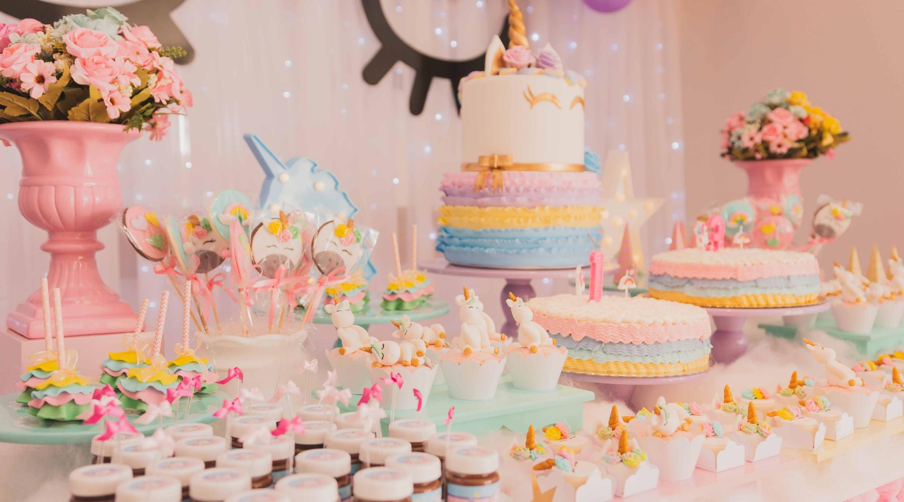 Unicorn birthday dessert table setup