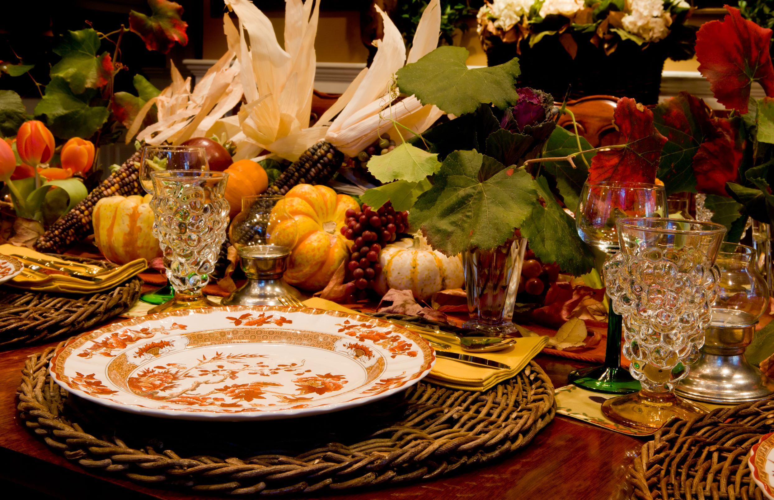 Traditional thanksgiving table with season's harvest centerpiece.