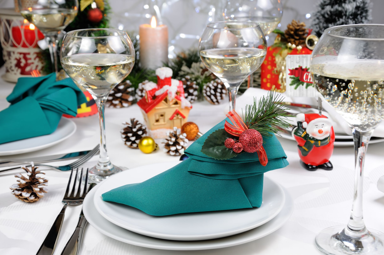 Fancy table napkin fold on a Christmas table setup.