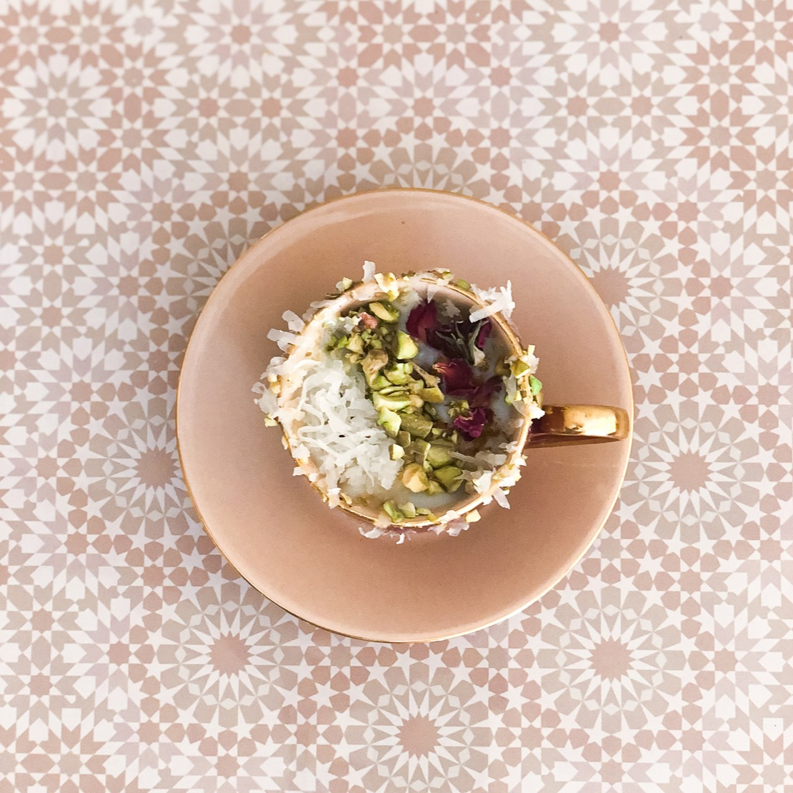 Cup of Sahleb topped with rose pistachio