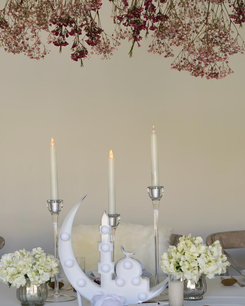 White marquee centerpiece on white tablescape