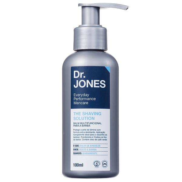 Em artigo sobre quatro produtos muito errados para fazer a barba (barbear), imagem mostra produto Balm para Barba Shaving Solution, da Dr. Jones, de embalagem cor cinza, rótulo azul e branco e fundo branco.