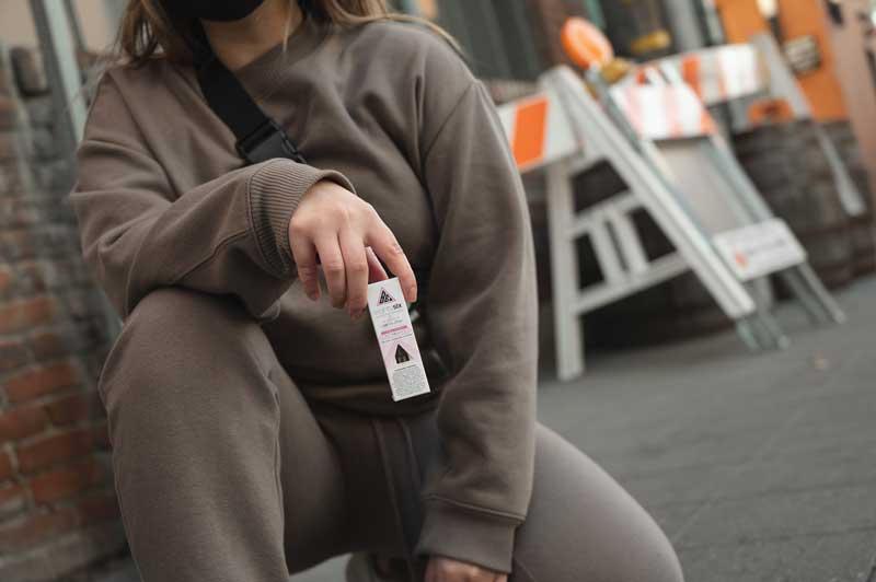 Person holding Fruity Pebbles OG Delta-8 cartridge