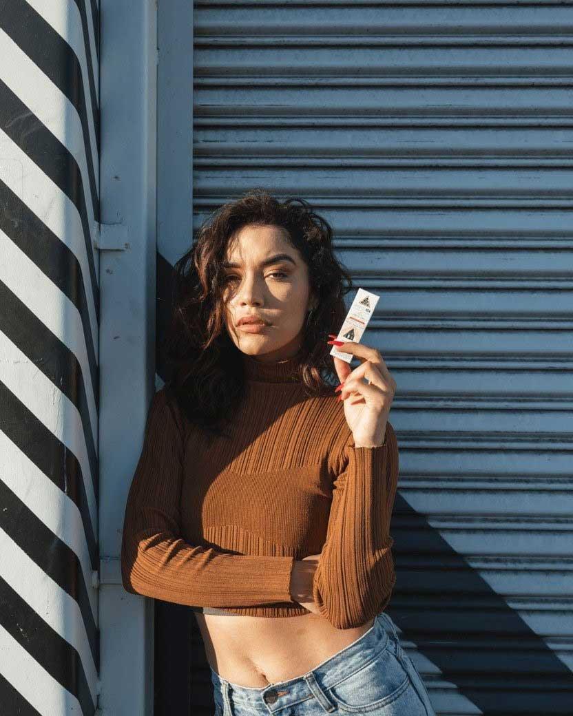 Woman holding a Delta-8 cartridge