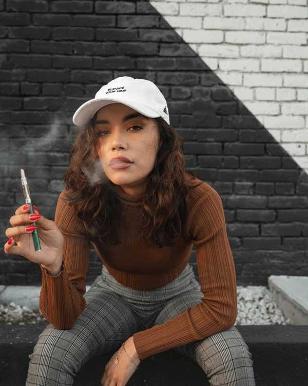 a woman with a vape pen