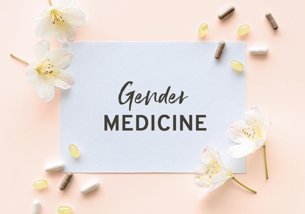 Das Wort Gendermedizin auf einem weißen Blatt vor rosa Hintergrund