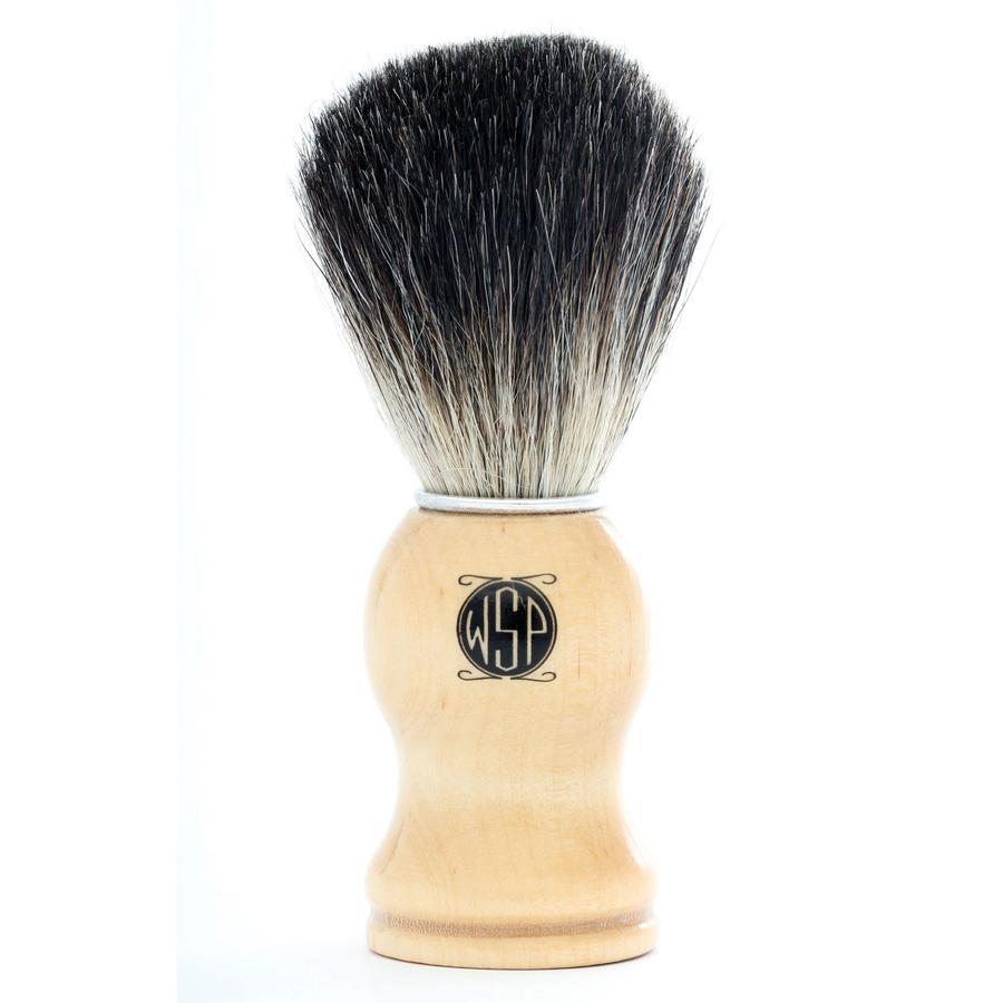 A high density 100% pure black badger hair shaving brush standing upright