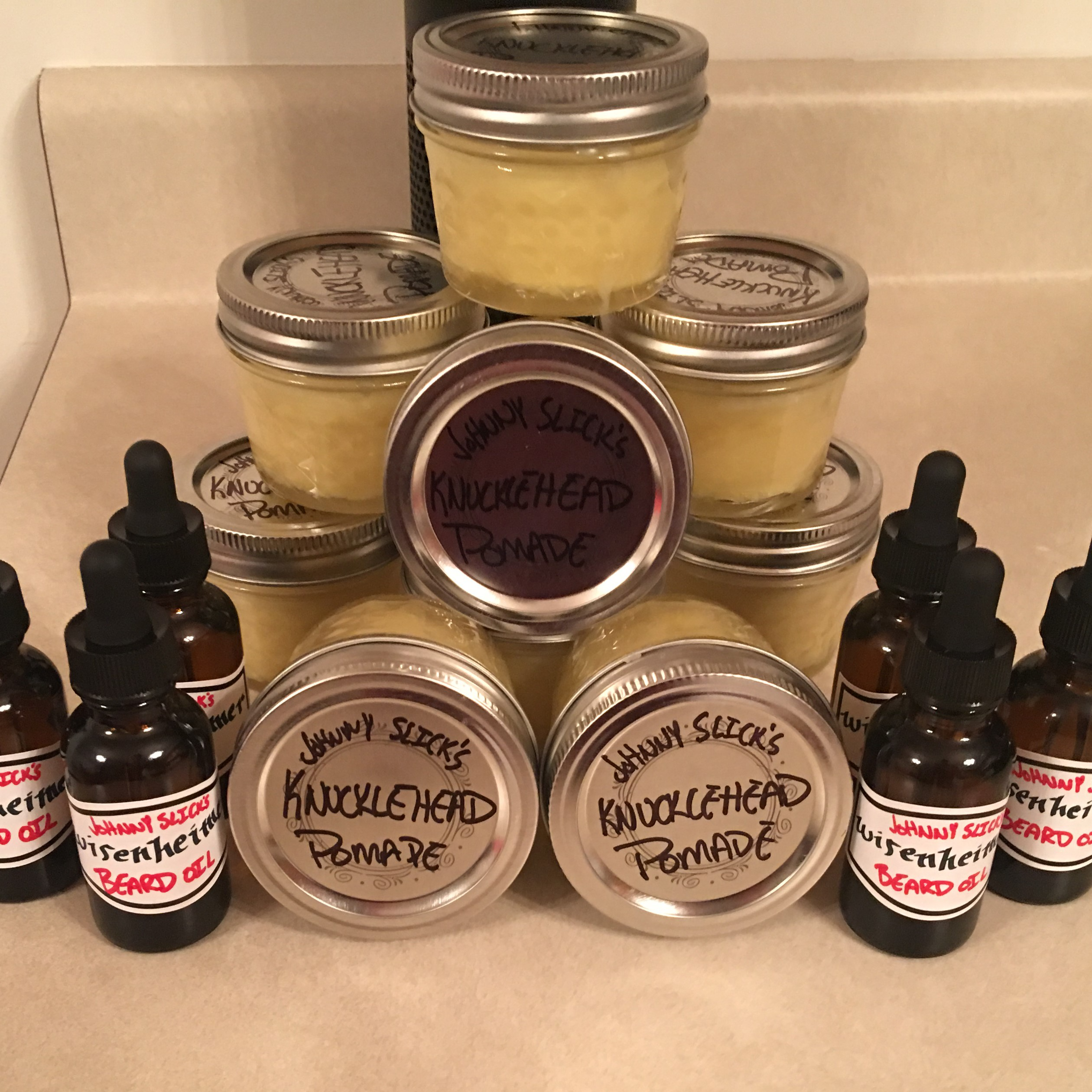 Some of the first products ever made by Johnny Slicks. Pomades in mason jars, and beard oils in drippers.