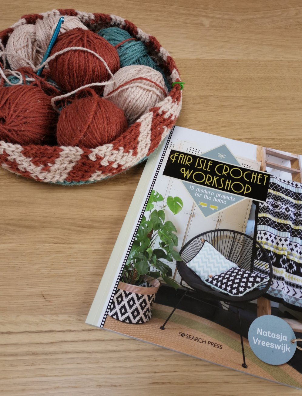 'Fair Isle Crochet Workshop' book on my dining table with the beginnings of my plant holder from the book.  My version is in a deep copper and warm cream coloured itchy as wool.